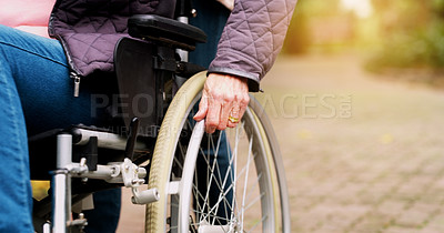 Buy stock photo Cropped shot of an unrecognizable elderly woman in a wheelchair outside in a park during the day