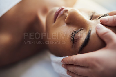 Buy stock photo Shot of a young woman getting a head massage at a spa