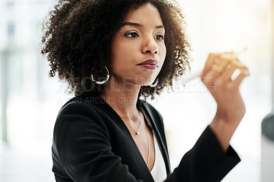 Buy stock photo Cropped shot of an attractive young businesswoman strategizing on a whiteboard in her corporate office