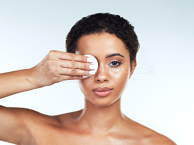 Buy stock photo Portrait of an attractive young woman posing while covering her one eye with a cotton pad against a white background