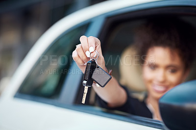 Buy stock photo Cropped portrait of an unrecognizable businesswoman holding up her car keys while sitting in her new car