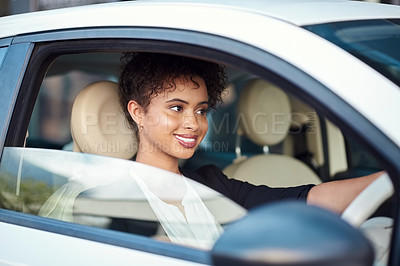 Buy stock photo Cropped shot of an attractive young businesswoman smiling while driving her new car