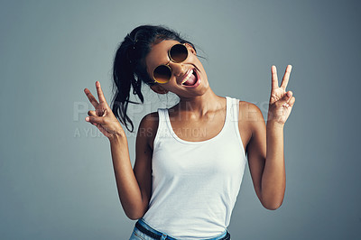 Buy stock photo Studio portrait of a beautiful young woman giving you two peace signs against a grey background