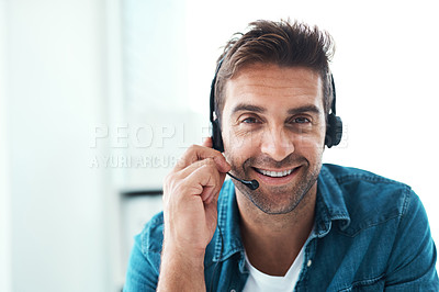 Buy stock photo Portrait of an attractive young call centre agent working in his office