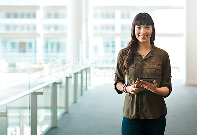 Buy stock photo Portrait of a beautiful young businesswoman standing in an office