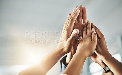 Buy stock photo Shot of a group of unrecognizable businesspeople high fiving in an office