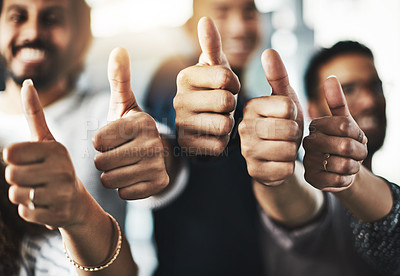 Buy stock photo Cropped shot of a group of businesspeople showing thumbs up