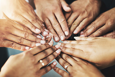 Buy stock photo Cropped shot of a group of unrecognizable people putting their hands together