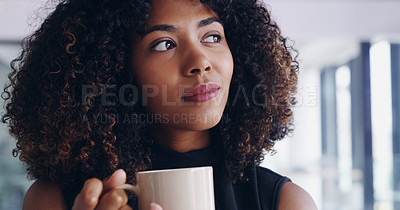 Buy stock photo Shot of a young businesswoman looking thoughtful while drinking coffee in an office