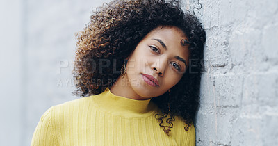 Buy stock photo Portrait of a confident young woman standing against a grey wall