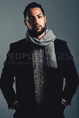 Buy stock photo Studio portrait of a handsome and stylish young man posing against a grey background