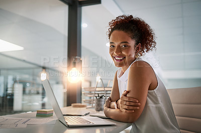 Buy stock photo Portrait of a young businesswoman working on her laptop during a late night in the office