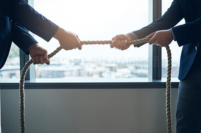 Buy stock photo Cropped shot of two businessmen pulling on a rope in a game of tug of war