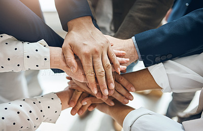 Buy stock photo Cropped closeup of a group of unrecognizable businesspeople making a huddle with their hands inside of the office during the day