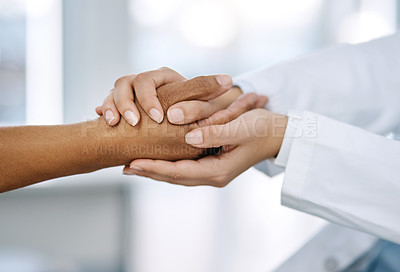 Buy stock photo Closeup shot of an unrecognizable doctor holding a patient's hand in comfort