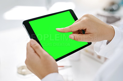 Buy stock photo Closeup shot of an unrecognizable scientist using a digital tablet with a chroma key screen in a lab
