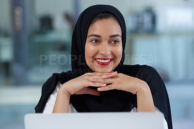 Buy stock photo Shot of a young businesswoman using a laptop in a modern office