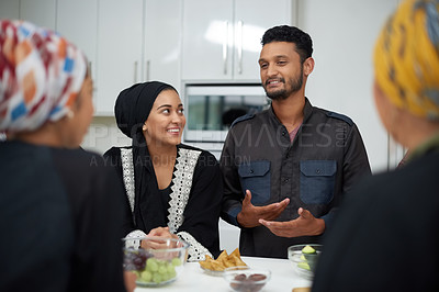Buy stock photo Shot of a group of young muslim friends enjoying themselves at a gathering indoors