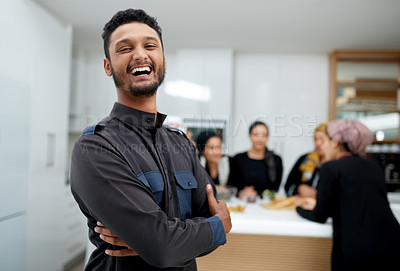 Buy stock photo Portrait of a handsome young muslim man at a gathering with friends indoors