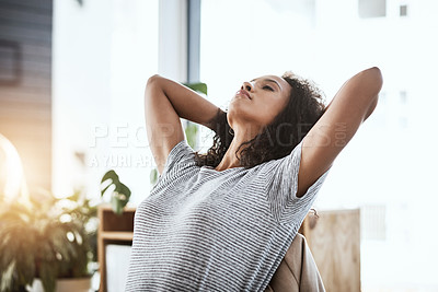Buy stock photo Shot of a woman looking relaxed with her hands behind her head while sitting at her desk