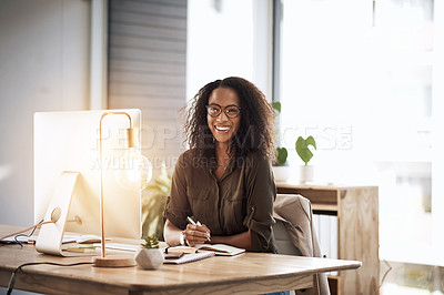 Buy stock photo Portrait of a young businesswoman working at her desk