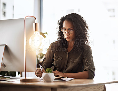 Buy stock photo Cropped shot of a businesswoman working at her desk