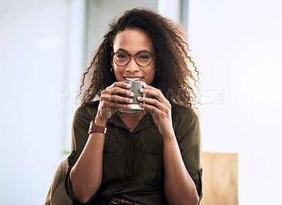 Buy stock photo Cropped shot of a businesswoman enjoying a cup of coffee at the office