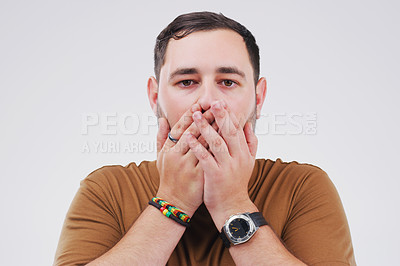 Buy stock photo Studio shot of a young man looking shocked against a grey background