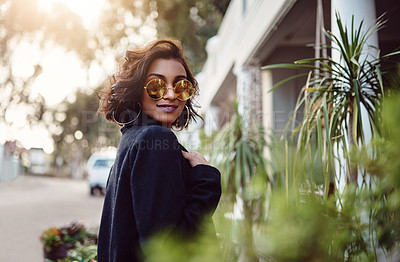 Buy stock photo Shot of a fashionably dressed woman standing outside