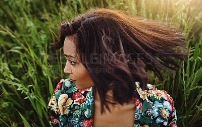 Buy stock photo Shot of an attractive young woman posing outdoors