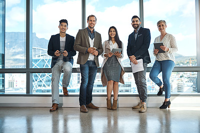 Buy stock photo Portrait of a diverse group of businesspeople using wireless technology in an office