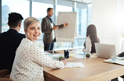 Buy stock photo Portrait of an attractive businesswoman during a meeting with colleagues in an office
