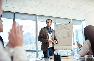Buy stock photo Shot of businesspeople applauding during a presentation in an office