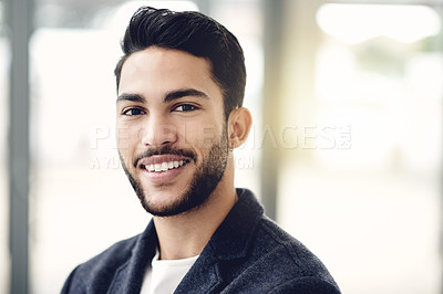 Buy stock photo Cropped portrait of a handsome young businessman standing in his office