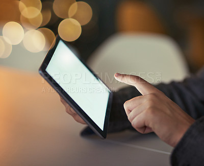 Buy stock photo Cropped shot of a businessman using a digital tablet during a late night at work