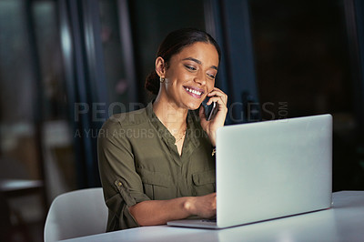 Buy stock photo Shot of a young businesswoman using a laptop and smartphone during a late night at work
