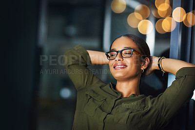 Buy stock photo Cropped shot of a cheerful young businesswoman working on a computer in the office at night