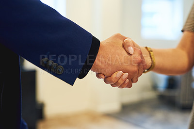Buy stock photo Shot of two unrecognizabe people shaking hands in an office