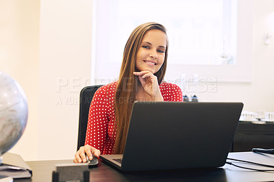 Buy stock photo Portrait of a beautiful young businesswoman working on her laptop in her office