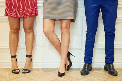 Buy stock photo Shot of three unrecognizable businesspeople standing in line in an office