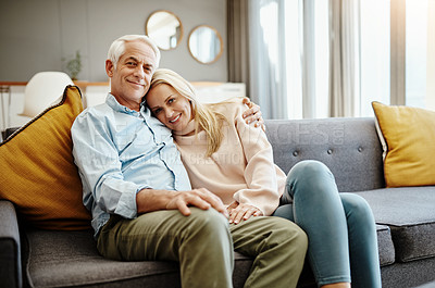 Buy stock photo Shot of a happy mature couple relaxing on the sofa at home