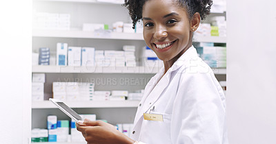 Buy stock photo Cropped portrait of an attractive young pharmacist holding a digital tablet in a chemist
