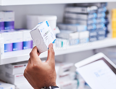 Buy stock photo Closeup shot of an unrecognizable pharmacist holding a box of medication in a chemist