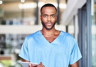 Buy stock photo Portrait of a young medical practitioner using a digital tablet in a hospital