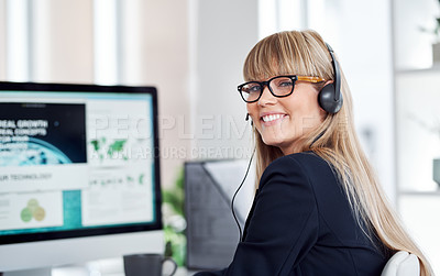 Buy stock photo Portrait of an attractive young female customer service representative wearing a headset and working in her office