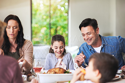 Buy stock photo Cropped shot of a cheerful family getting excited for their food at the dining table at home