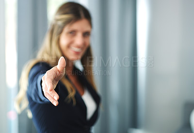 Buy stock photo Cropped shot of a businesswoman reaching for a handshake