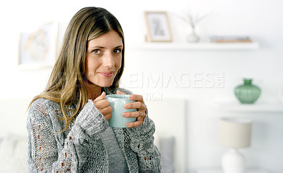 Buy stock photo Cropped shot of a woman enjoying a cup of coffee at home