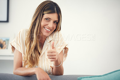Buy stock photo Cropped shot of an attractive woman showing thumbs up