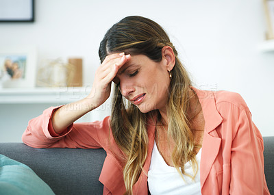 Buy stock photo Cropped shot of an attractive woman crying at home